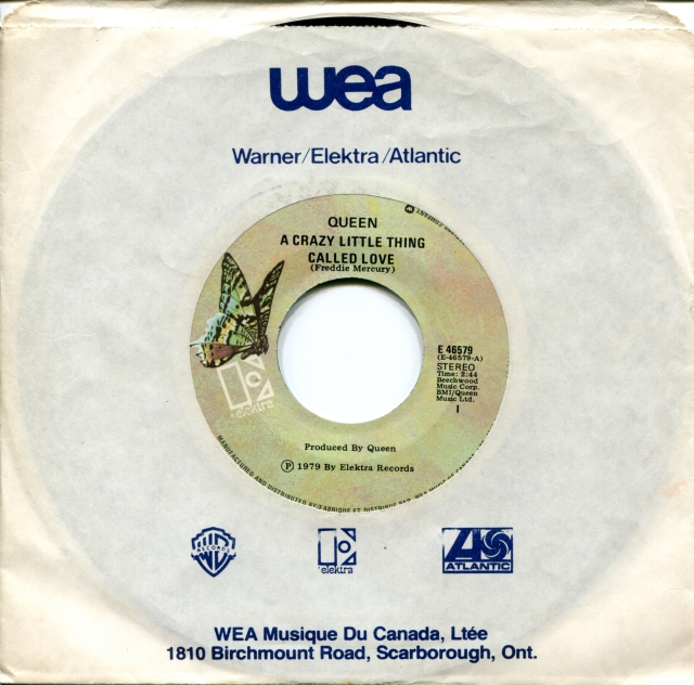 Crazy Little Thing Called Love / Spread Your Wings - ELEKTRA E 46579 CANADA (1979) ~ No PS. Green butterfly label