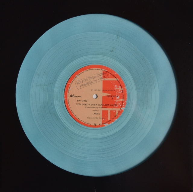 Crazy Little Thing Called Love / Bicycle Race (Long version) - EMI 446-1032 COLOMBIA (1979) ~ Light blue vinyl. Labels in Spanish